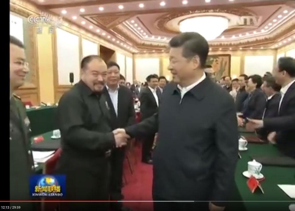 Xiao Xinguang shaking hands with Xi Jinping